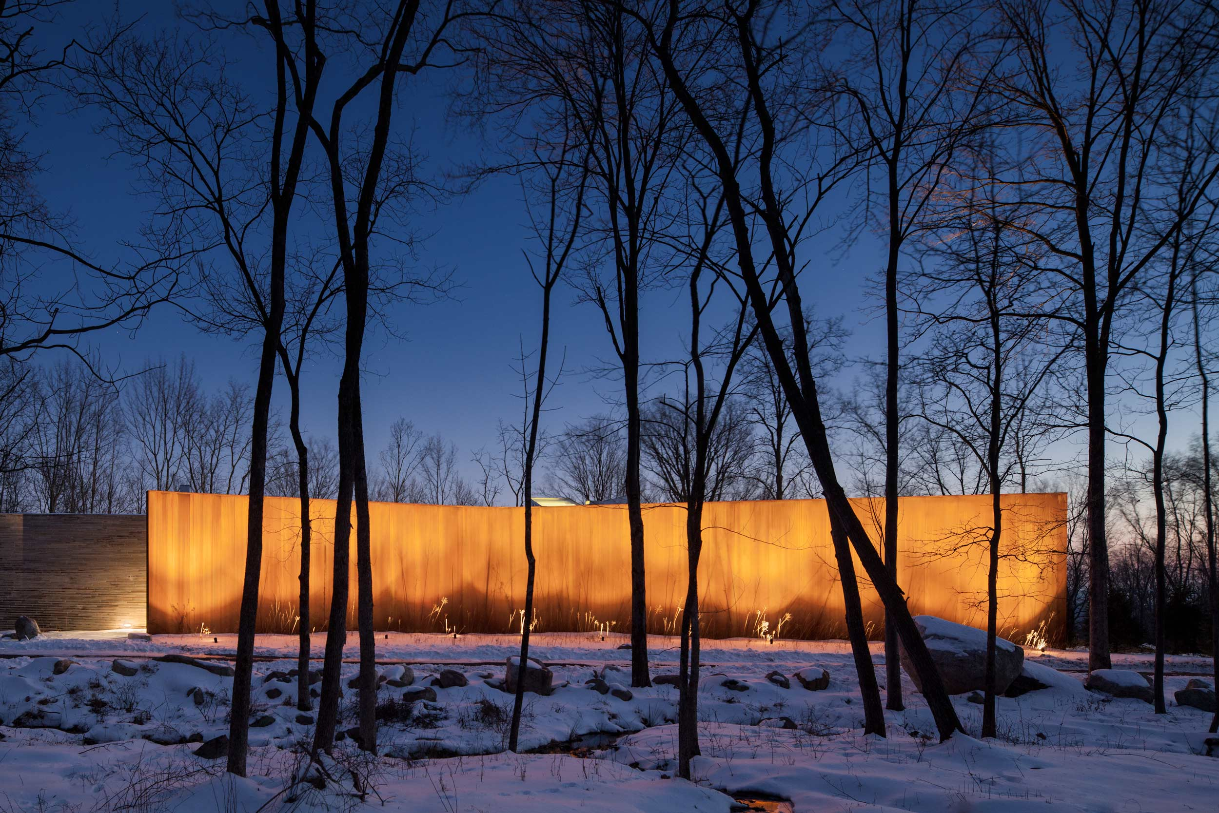 William Reue Architect House in the Woods with Corten Steel Wall in Snow