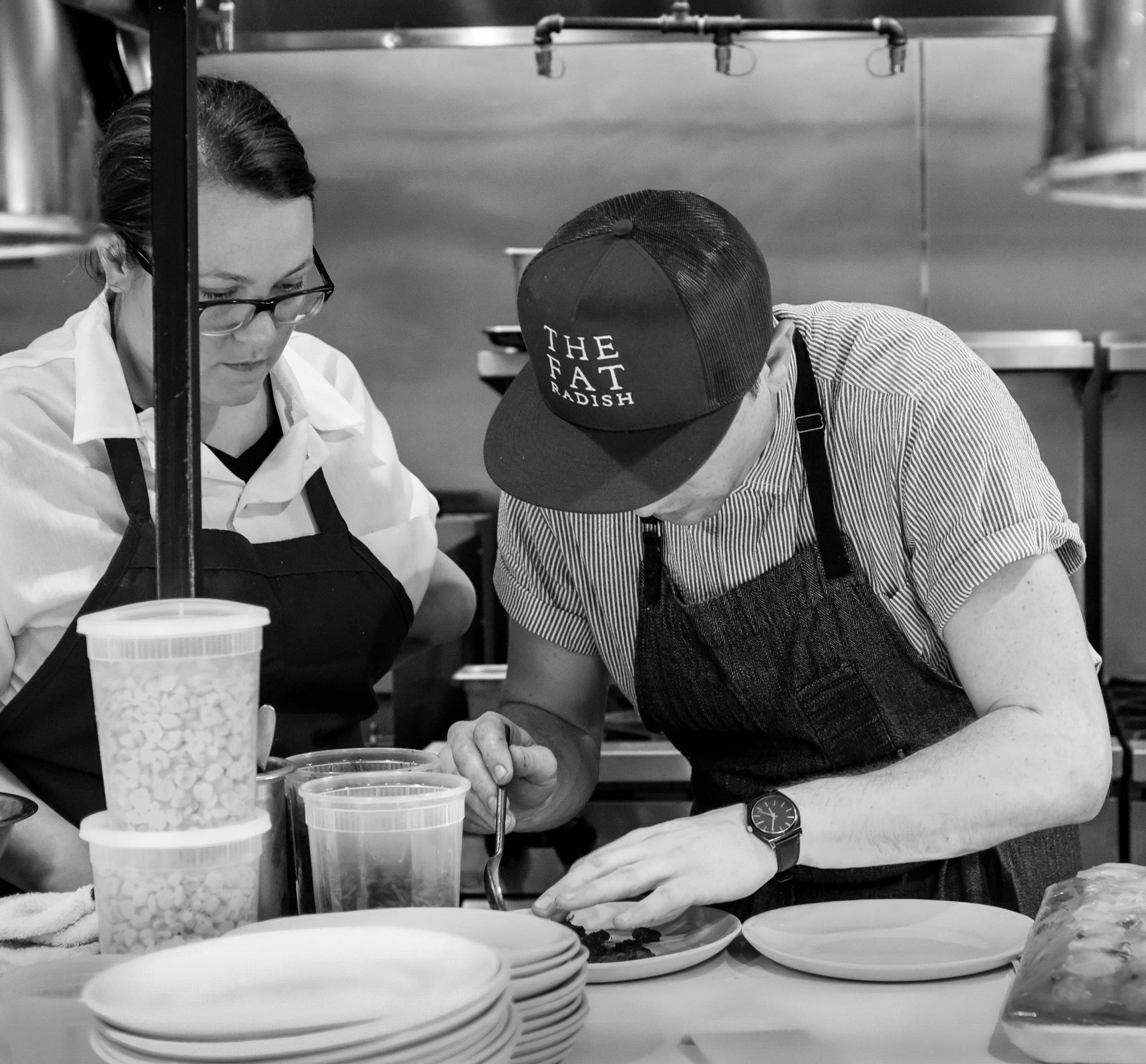 Chef Nick Wilbur Plating Food at Fat Radish pop-up at Basic Kitchen