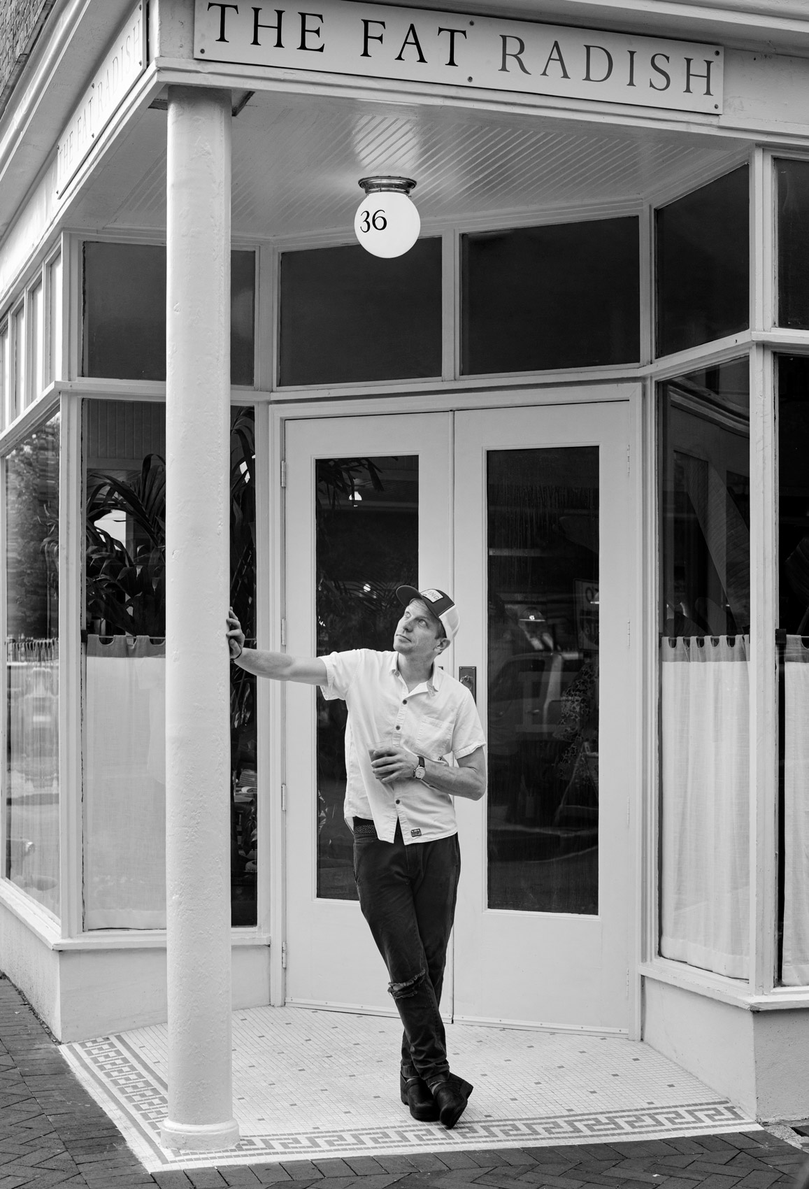 Chef Nick Wilbur Black and White Photography outside The Fat Radish in Savannah
